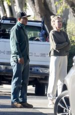 Melanie GriffithTalks to her landscaper outside her home in Los Angeles