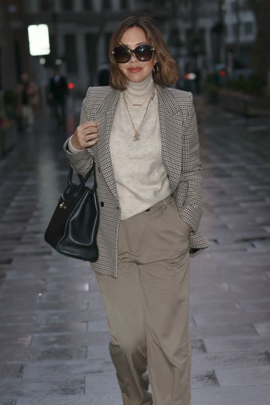 Myleene Klass Looks chic in a tweed jacket and trousers at Smooth radio in London