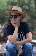 Natalie Portman Kicks back to enjoy the views while visiting a park with her family in Sydney