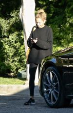 Nicole Richie Checks her phone on her way out after visiting a friend in West Hollywood