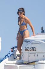 Olivia Culpo In blue bikini on a yacht in Cabo San Lucas