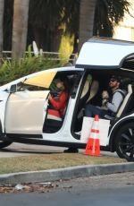Olivia Munn Picks up her friends in her Tesla before heading to Santa Monica