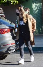 Olivia Wilde Is pictured picking up a guitar at a store in Los Angeles
