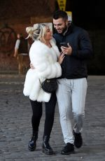 Paige Turley and Finley Tapp look all loved up on a morning stroll along the canal in Manchester