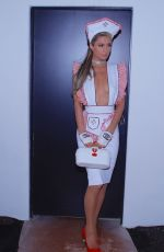 Paris Hilton Arrived at party dressed in a nurses outfit with matching white vintage Chanel fingerless gloves in Los Angeles