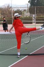 Phoebe Price Gets her stretch in as she hits the tennis courts in all red in Los Angeles