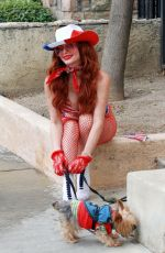 Phoebe Price With her dog and posing with a patriotic outfit on Friday in Los Angeles
