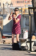 Pom Klementieff Has fun in a squares with Simon Pegg while making videos with her mobile phone in Venice