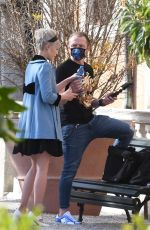 Pom Klementieff Spotted making videos with her mobile phone with Simon Pegg in the gorgeous gardens of Venice