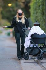 Sophie Turner Goes out for an evening stroll with daughter Willa near her home in Los Angeles