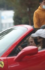 Vanessa Hudgens Drives her red Ferrari as she exits the gym with GG Magree in West Hollywood