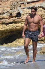 Yazmin Oukhellou and James Lock seen taking a loved up walk along the beach in Cyprus