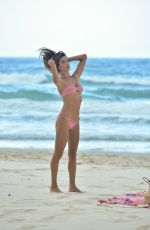 Alessandra Ambrosio Shows her curves at 39 in a tiny pink bikini during a walk on the beach in Florianopolis