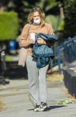 Alicia Silverstone Wears cozy and warm clothing while leaving a gym session in West Hollywood