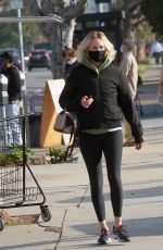 Amber Valletta Grabs tacos from a truck in LA