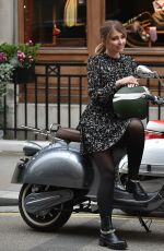 Amy Hart Seen filming an advert for Velo scooters around London