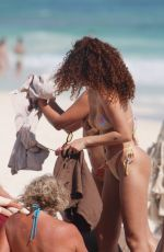 Ashley Moore Plays in the sunshine taking pictures and snapping selfies with friends at the beach in Tulum