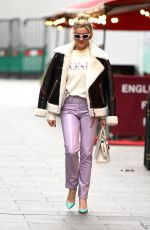 Ashley Roberts Pictured in denim, a printed top and pvc trousers at the heart radio studios in London