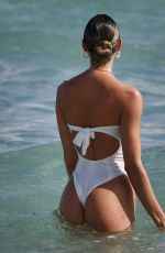 Candice Swanepoel Hits the beach with her family in Miami