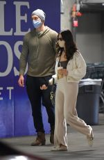Eiza Gonzalez Flashes her toned abs in a crop top, with a white sweater and pants in New York
