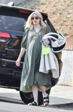 Emma Roberts Looks stylish in a green midi dress as she heads to an appointment in Los Angeles