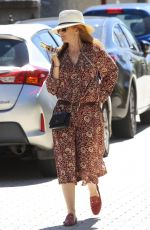 Isla Fisher Steps out wearing a floral summer dress in Sydney