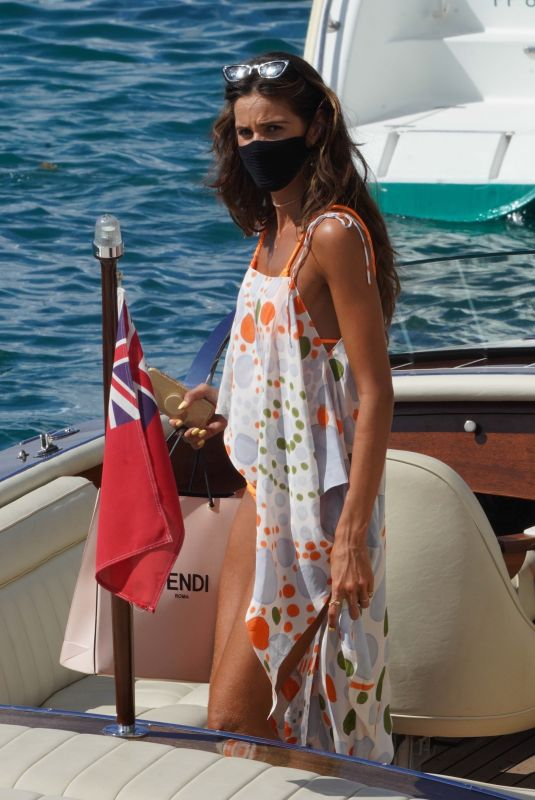 Izabel Goulart Enjoys a cigarette as she gets a lift to a mega-yacht without fiance Kevin Trapp in St. Barths