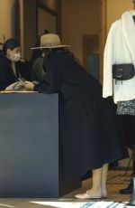 Katharine McPhee Hides her baby bump with a long black coat on a coffee and shopping outing with a friend in Beverly Hills