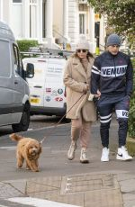 Kelly Brook Is seen out for a stroll with Jeremy Parisi and their dog in London