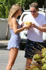 Kimberley Garner Drinking fresh coconut water roadside as she is spotted out in Holetown, St James