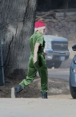 Kristen Bell Gets in the holiday spirit dressed in a green jumper and red Santa hat in Los Angeles