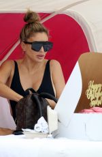 Larsa Pippen Shows off her curves in a black one piece as she hits the beach with BFF Michelle Pooch in Miami