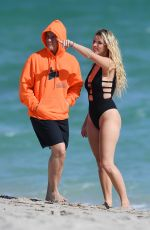 Lele Pons Wearing a black swimsuit with her boyfriend Guaynaa in Miami Beach