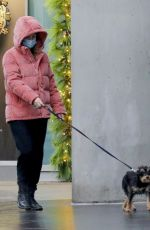 Lili Reinhart Walking her dog in the rain in Vancouver