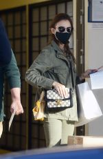 Lily Collins Visits the post office in Beverly Hills