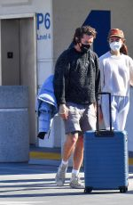 Margaret Qualley & Shia LaBeouf Spotted for the first time as a couple during a make out session at LAX in Los Angeles