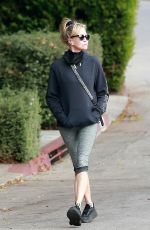 Melanie Griffith Enjoys some fresh air while out for a solo afternoon walk around her neighborhood in Beverly Hills