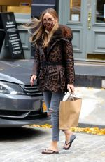 Olivia Palermo Has a hair raising moment on a windy day after getting a pedicure in Manhattan
