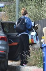 Olivia Wilde Has her hands full as she arrives at her ex Jason Sudeikis
