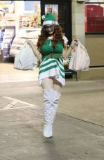Phoebe Price Does some shopping in an elf outfit