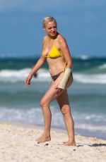 Rose McGowan Dotes on her pet pooch during a trip to Mexico beach in Tulum
