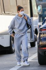 Sara Sampaio Catches a flight out of LAX international airport sporting an all grey track suit from ALO