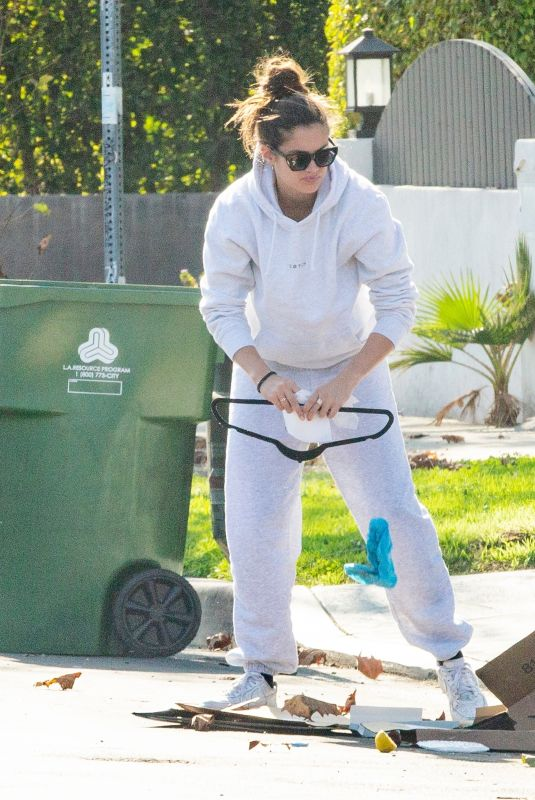 Sara Sampaio Cleaning up outside her home in Los Angeles