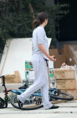 Sara Sampaio Steps out in her comfy pajamas to receive a shipment and clean out her garage in Los Angeles