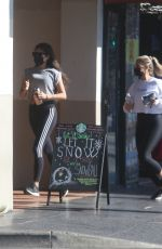 Shay Mitchell Goes for a power walk with a friend in Hollywood