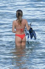 Sydney Sweeney Heats up the beach in a red bikini in Maui on Hawaii