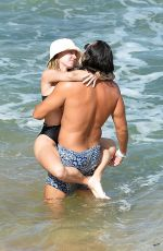 Sydney Sweeney Spotted twice on the beach with a mystery man in Maui