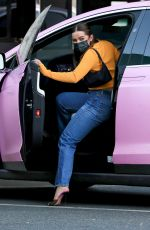 Addison Rae Hops into her pink Tesla after shopping at XIV Karats LTD jewelry store in Beverly Hills