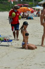 Alessandra Ambrosio Exercises with her personal trainer and best friend on the beach in Florianopolis
