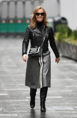 Amanda Holden Looks stylish and chic in a Sosandar skirt and Dune London Boots outside the Global Radio Studios in London